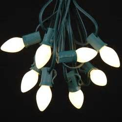 white ceramic c7 outdoor string light set on green wire