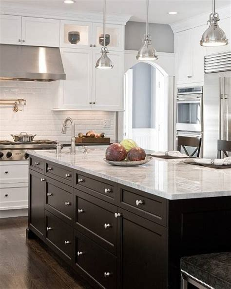 white kitchen with black island black kitchen cabinets and white appliances the interior