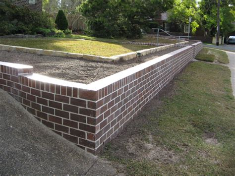 wood and brick retaining wall which is better brick