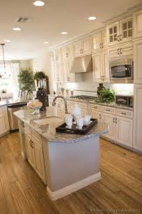White Kitchen Cabinets Wood Floors by Antique White Kitchen With Wood Floors And An Island Sink