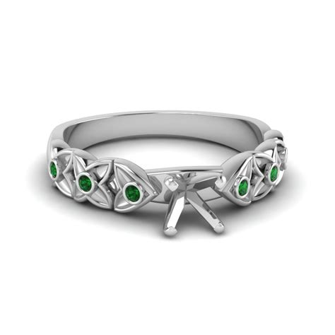 side engagement ring setting with emerald in white