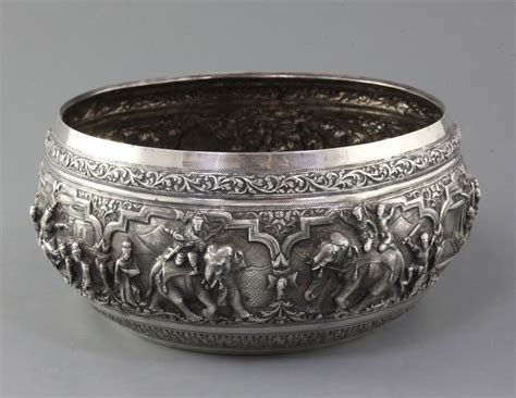 Ac 2436 Silver a late 19th century burmese silver bowl embossed with continuous of figures and animals at