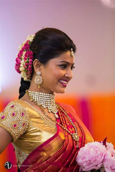 bollywood actress hairstyles in saree traditional southern indian bride wearing bridal saree