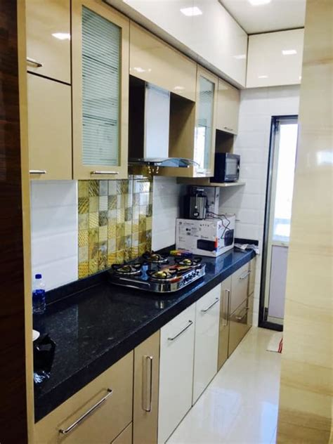 parallel kitchen  wooden cabinets  false ceiling