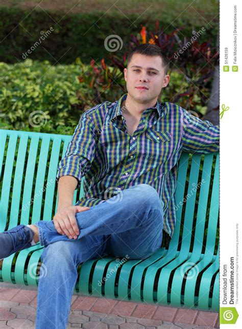 guy sitting on bench man with leg crossed stock image image of bench well