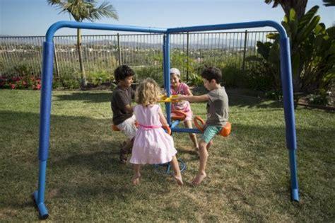 backyard merry go round kids ironkids four station fun filled merry go round endurro