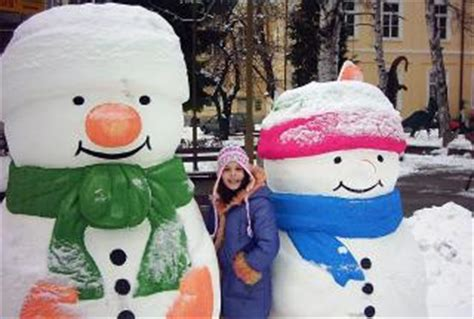 commercial woman hits snowman snowmen and a girl photo free download
