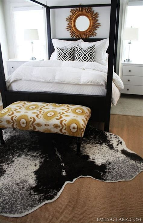 cowhide rug bedroom layering rugs in our bedroom cowhide over sisal rug my