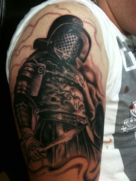 tattoo on gladiators arm gladiator tattoo designs full and half sleeve tattoos