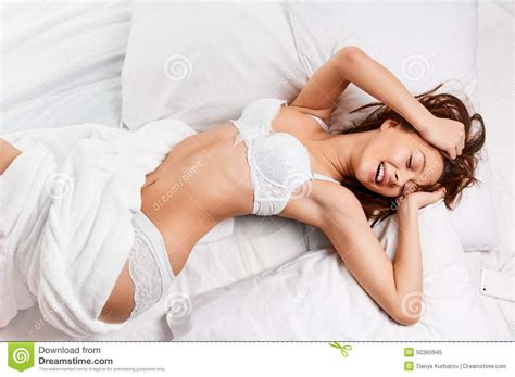 lying or laying in bed sensual woman laying in bed stock image image of beauty