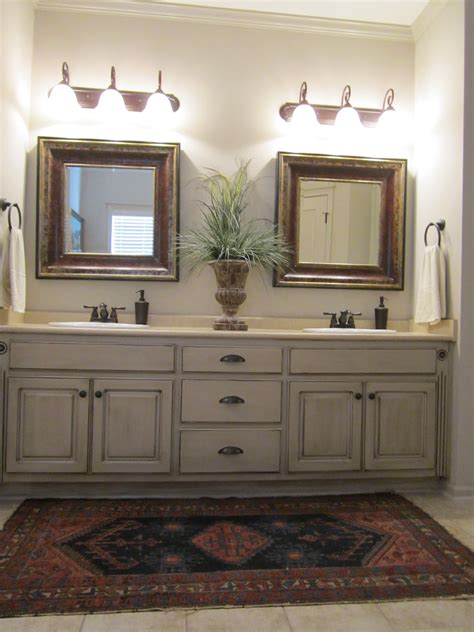 these painted bathroom cabinets and the lights what i would like to paint all the cabinets
