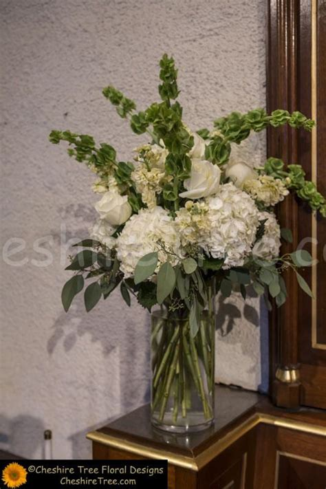 Clear Glass Vases Clear Glass Vases Held White Green And Cream Flowers