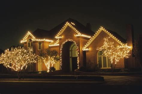 attching christmas lights to moden house lighting up your 2015 in naples florida neafamily