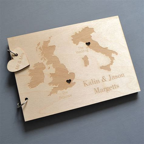 wedding guest book pictures personalised duo destination map guest book by clouds and