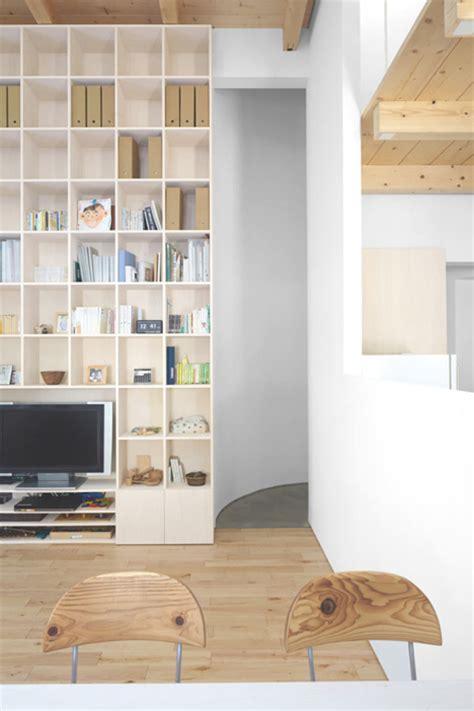 ceiling to floor bookshelves gem home s plain exterior hides a interior