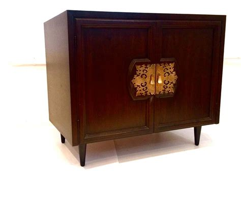asian modern small cabinet designed by bert for