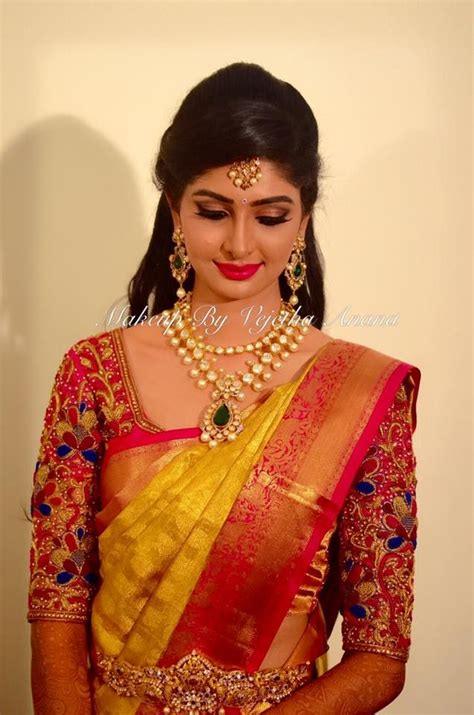 hairstyle design for saree traditional southern indian bride aishwarya wears bridal