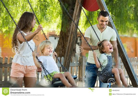 moms swing parents with kids at swings stock photo image 46482942