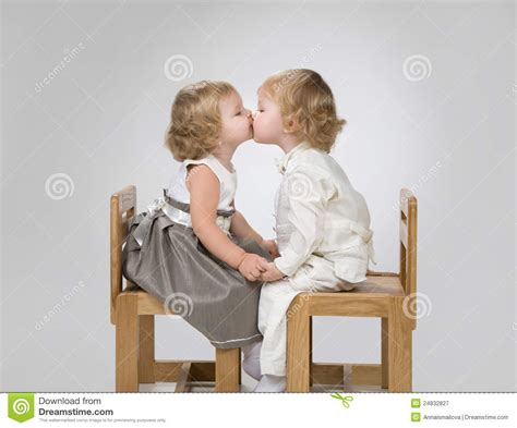 girl and boy kissing in bathroom two little babies kiss royalty free stock photography