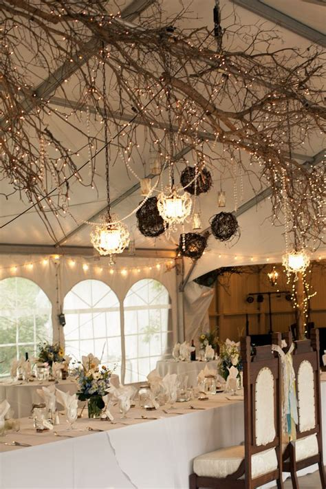 rustic indoor wedding decoration with tree braches and