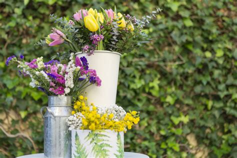 Pretty Flower Vases by Vases With Pretty Flowers And Blurred Background Photo