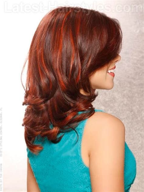pictuted of red highlights on dark hair with spiky cut 11 hot red highlights to add to your hair bucket list