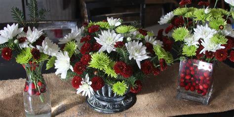 make three beautiful christmas flower arrangements