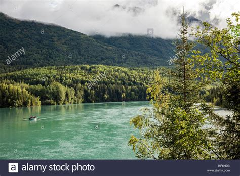 drift boat kenai river boats floating down river in stock photos boats floating