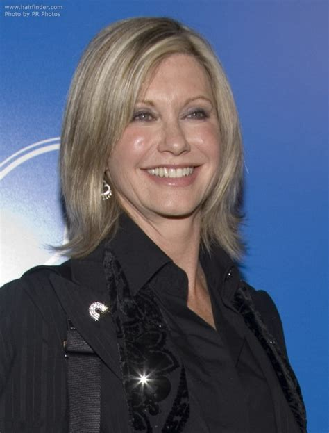 olivia newton john hairstyles pictures olivia newton john with medium length flip hairstyle