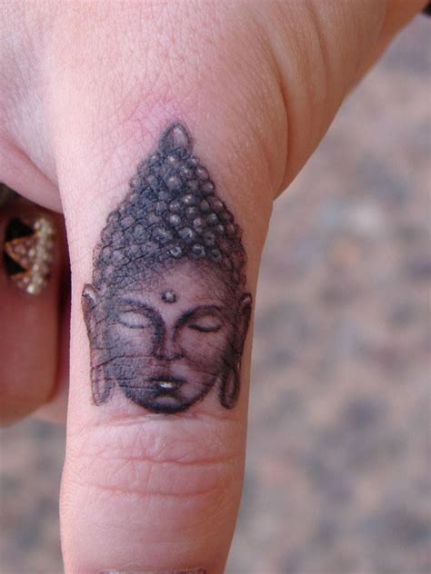 small buddha tattoo 50 exceptional finger tattoos creativefan