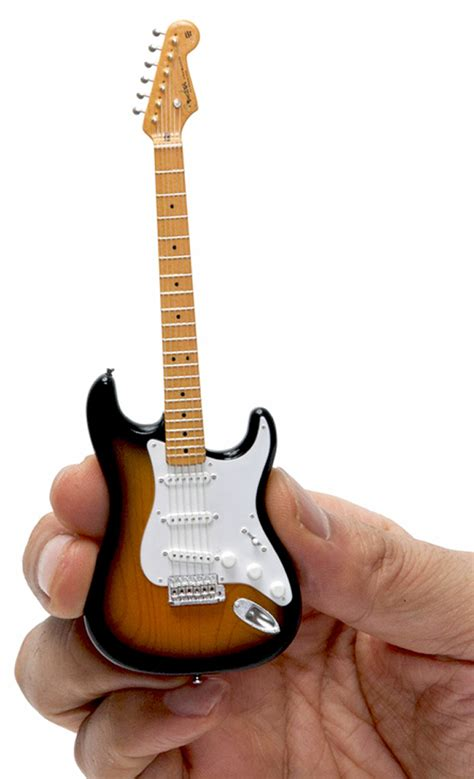 Kalung Pasangan Mini Plat Guitar tiny guitars are finger pluckin technabob