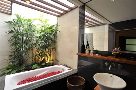 tropical bathrooms lovely red rose petals in white bathtub inside comfy tropical bathrooms with white