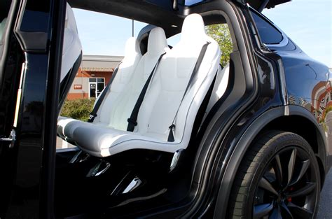 tesla model x seating tesla model x quot ultra white quot seats tested against coffee
