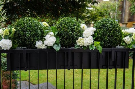 window box planters for railings artificial geranium and boxwood trough metals window
