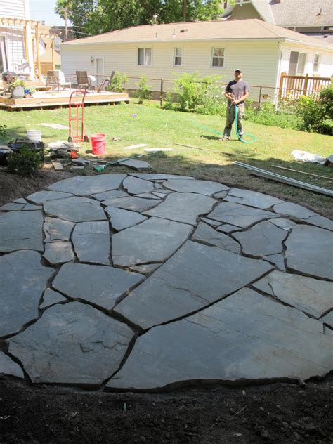 backyard flagstone how to install a flagstone patio with irregular stones diy network blog made