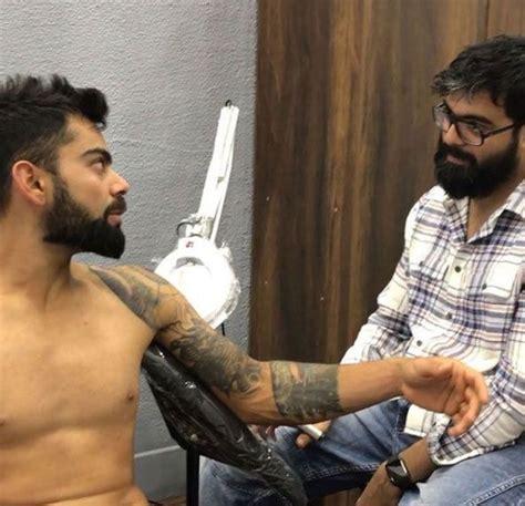 tattoo on virat kohli s arm virat kohli gets a new haircut as ipl 2018 approaches