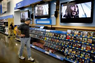 wal mart steps up its in electronics aisle wsj