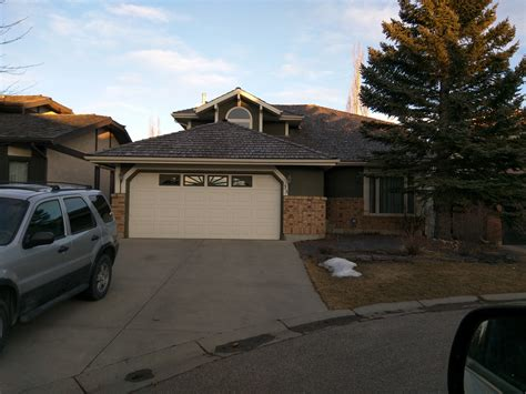 calgary house painters calgary exterior house painting 10 year stucco painting 1 coat paint job 1 2 price