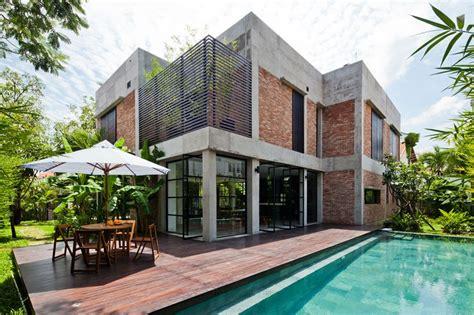 design house vietnam mm architects wraps vietnamese villa with pivoting doors
