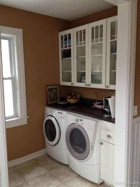 laundry in kitchen white mission kitchen traditional laundry room boston by cliqstudios cabinets