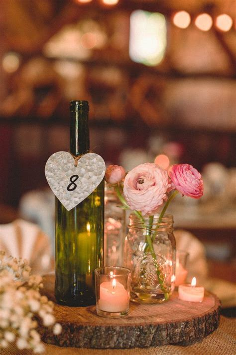 rustic wine bottle centerpieces fall barn wedding receptions wedding and jars