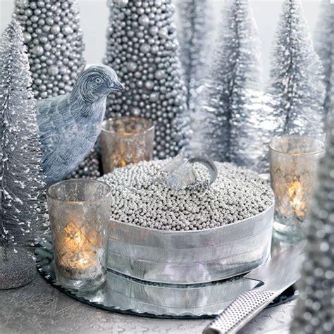 heap silver sugar dragees onto a cake magical modern