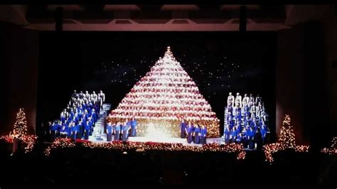 angels we have heard on high by singing christmas tree