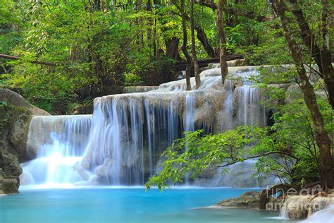 Tropical Wall Mural erawan waterfall in thailand photograph by noppakun wiropart