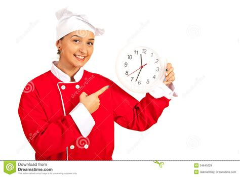 Free Kitchen Design App chef woman indicate to clock royalty free stock images