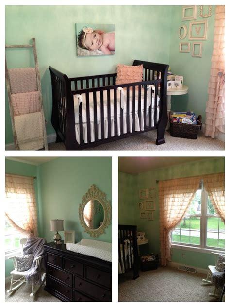 mint pink nursery  deep wooden crib nursery dark