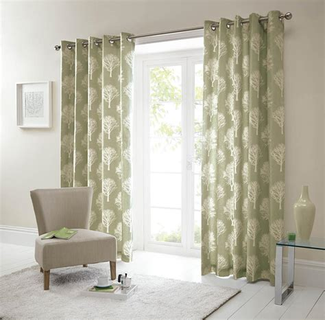 green eyelet curtains uk woodland eyelet curtains in green free uk delivery