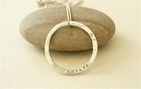 Handmade Personalised Jewellery - win a sterling silver personalised hammered circle pendant