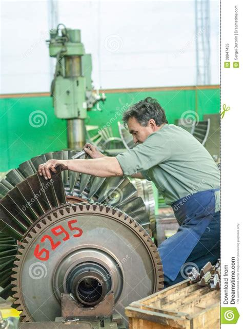 Turbine Engine Mechanic by Mechanic Assembles Turbine For Aviation Engine Editorial