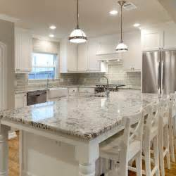 white cabinets with grey countertops white granite countertops and glass subway tile backsplash